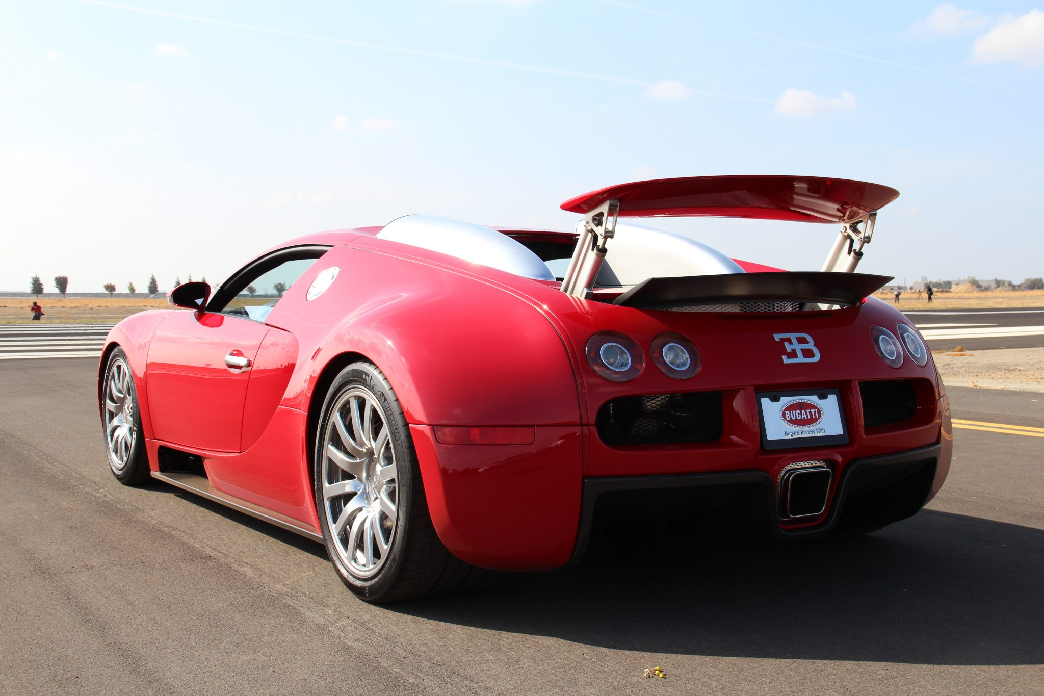 Rear 3/4 view of a red Bugatti Veyron