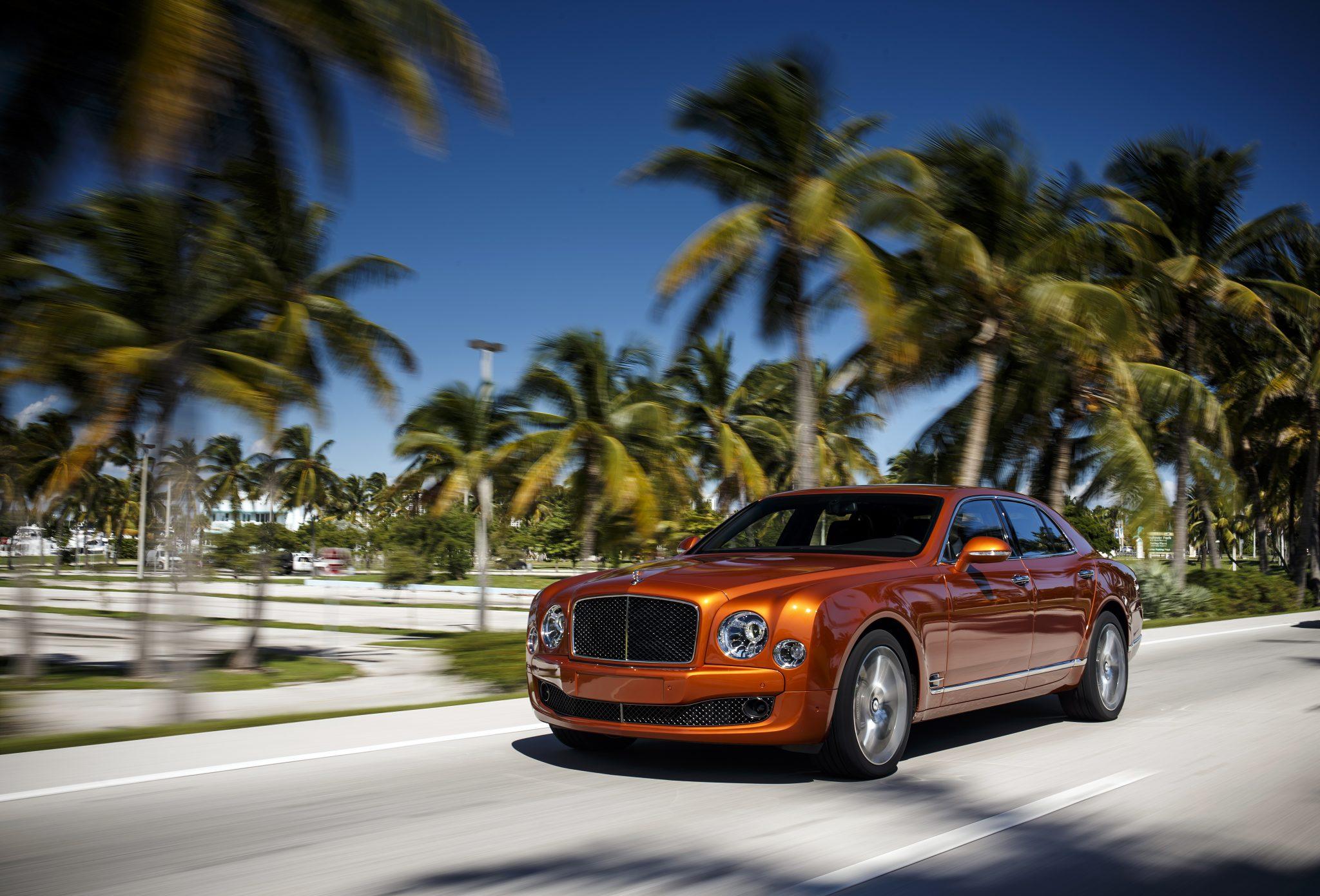 A 2015 Bentley Mulsanne Speed cruising through a palm tree lined street