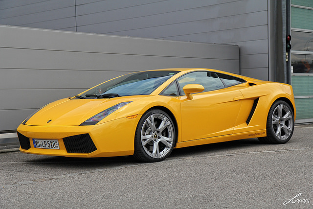 A side profile shot of a 2006-Lamborghini-Gallardo-in yellow parked in an industrial area