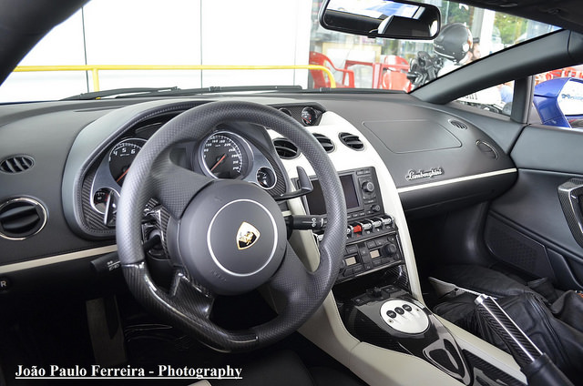 Interior shot of a 2010-Gallardo-LP550-2-Valentino-Balboni-taking from the drivers seat showing the white center console and carbon fiber trim pieces