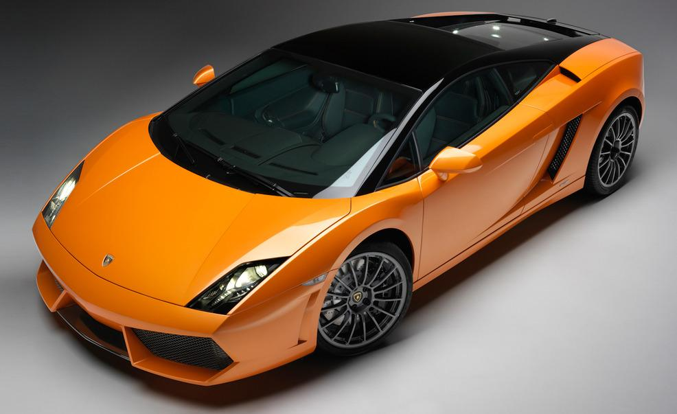 Elevated 3/4 front profile photo of a 2011 Lamborghini Gallardo LP550-2 Bicolore in orange with black accents