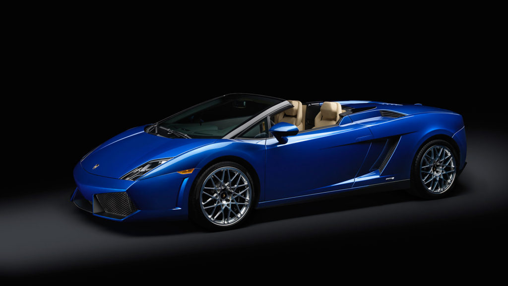 A slight off angle profile shot of a 2012 Lamborghini Gallardo LP550-2 Spyder in blue metallic