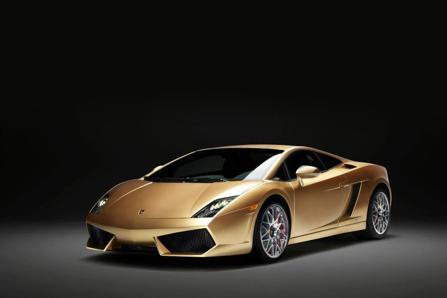 Front 3/4 press photo of a 2012-Lamborghini-Gallardo-LP560-4-Gold-Edition-Oro-Elios