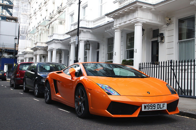 Lamborghini Gallardo LP550-2 Coupe orange parked on street in front of a nice white house, looks to be London