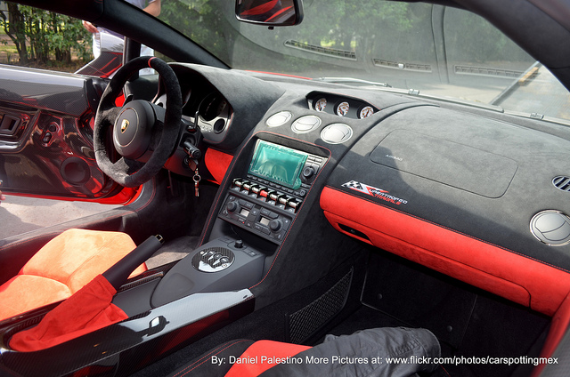 Interior shot from the passenger side of a Lamborghini-Gallardo-LP570-4-Super-Trofeo-Stradale finished in black and red alcantara