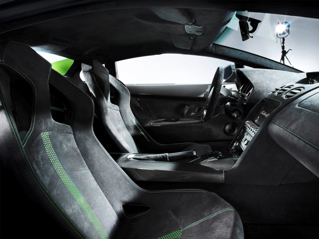 Interior shot of a Lamborghini-Gallardo-LP570-4-Superleggera showing the alcantara and carbon fiber surfaces with green stitching detail