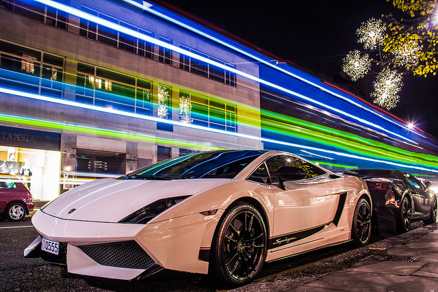Lamborghini-Gallardo-LP570-4-Superleggera in metallic white back to back with another Gallardo, time lapse shot with streaking lights above the cars