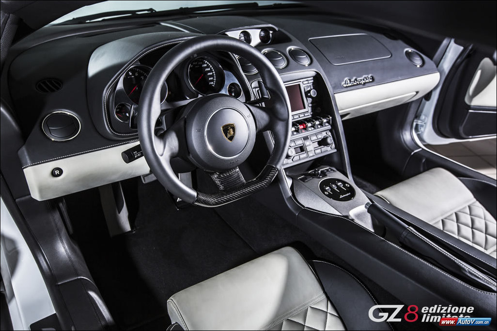 The interior of a Lamborghini-Gallardo-LP550-2-GZ8-Edizione-Limitata showing the white and black leather color scheme and carbon fiber bottomed steering wheel