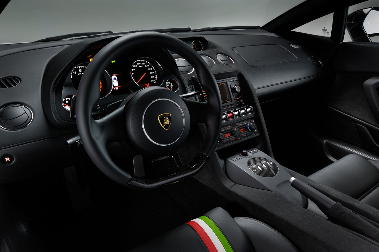 "Interior of a Lamborghini Gallardo LP550-2 Tricolore showing the ""tricolore"" stripe on the seats and the carbon fiber lower part of the steering wheel"