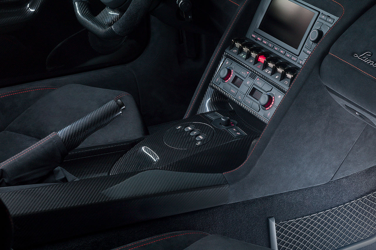 An interior photo of a Lamborghini Gallardo LP570-4 Edizione Tecnica from the passenger seat showing the extensive use carbon fiber and alcantara, and beautiful stitching work